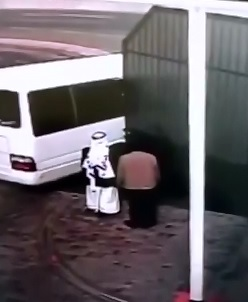 good CCTV - big iron fence crushes man in Saudi Arabia