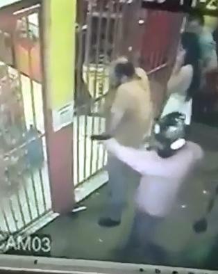 Helmet Wearing Hitman Executes Man through Iron Bars while Working