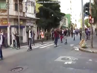 Car drives in skateboard group