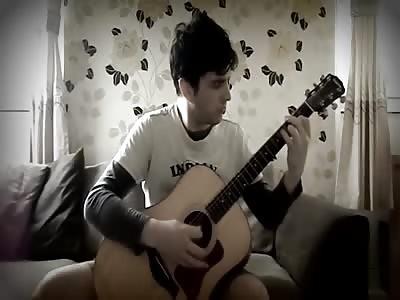 """Diablo  """"Tristam Village"""" on acoustic guitar"""