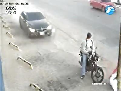 BIKER BRUTALLY HIT BY CAR