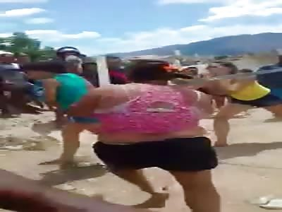 WOMEN BEATING WOMEN