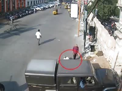 Jeep runs over beggar sitting in Street.