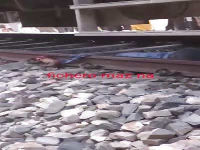 Dead man under train