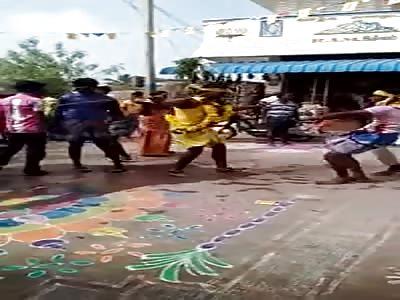 TRUCK PULLS PEOPLE DANCING IN FESTIVAL