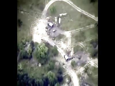 Drone Records Ukrainian Artillery Unit Taking Direct Hits