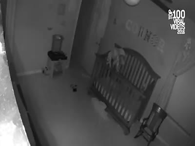 Baby Balances On the Edge of Crib