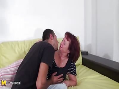 Mature sucks a hard cock
