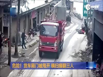 Truck's swinging door hits three riders to ground