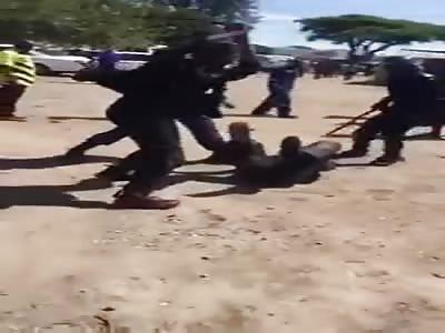 Police In Zimbabwe Beat Up Protestor
