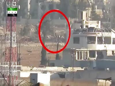 missil kills a group of al-Assad gangs and militias