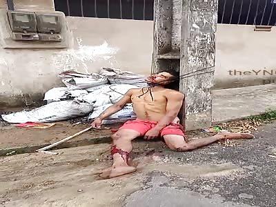 (shocking) man tied and lifeless