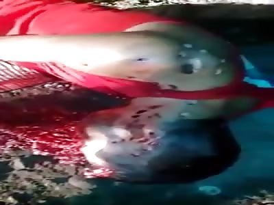 Disfigured man with shotgun on face