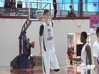 Giant kid playng basket