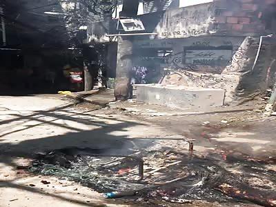 man burned  in favela