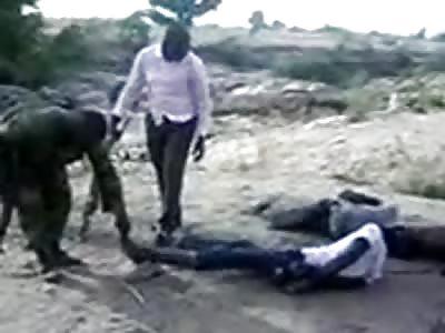 soldiers break the legs of 2 men