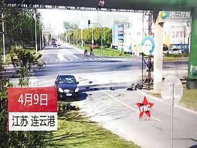 in Jiangsu  Motorcycle runs  a red light hits a car