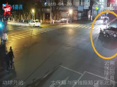woman gets  dragged under a car