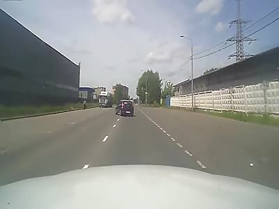 Motorcyclist Hits Car.