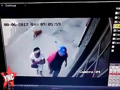Woman shot dead in the street