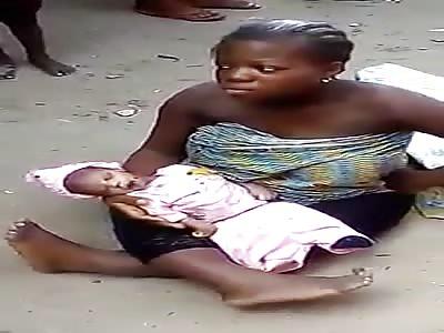 Woman with Crippled Legs Cradles Her Murdered Newborn Baby