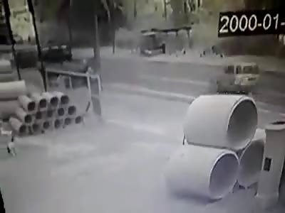Biker Gets Flattened by a Truck