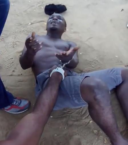 Handcuffed thief beaten by the Nigerian military