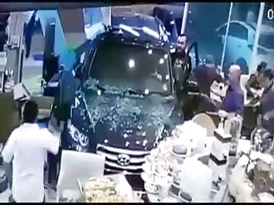 Car invades bakery