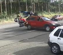 BOOM! Speeding Biker Crashes Head First into Turning Car