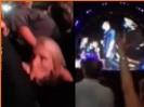 Slutty girl sucks off boyfriend on dancefloor during concert.