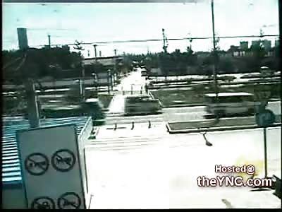 Biker completely flattened by a Dump Truck
