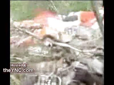 Georgian and Ukrainian Military take the Gun off a Dead Russian Pilot's body