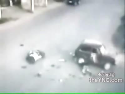 Speeding Bullet Motorcyclist almost Tips Car in Violent Collision (Fatal)