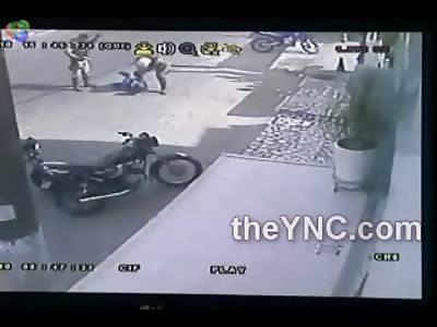 Police in Brazil TEE Off on Teenage Biker in broad Daylight