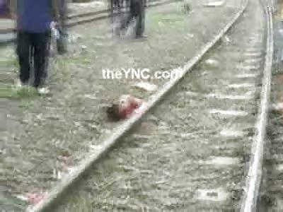 Punk Kid with a Punk Haircut dies in a Glorious Fashion chasing Trains