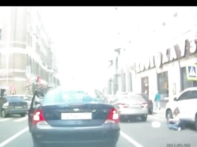Female Pedestrian Crossing Road is Hit by Maneuvering Car
