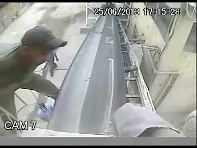 Careless Worker Gets Sucked into a Conveyor Belt