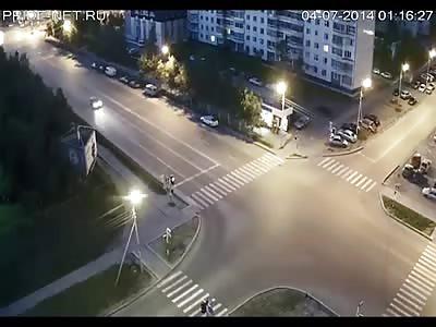 Driver runs a red light killing a pedestrian in the crosswalk