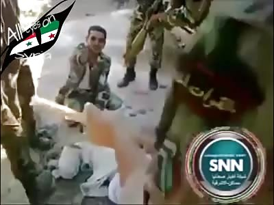 Soldiers torture alleged Syrian rebel.