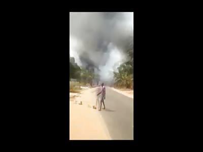 Man Walks Burned and Charred Down the Street