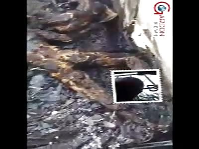 DEAD PEOPLE IN A BURNED BUILDING