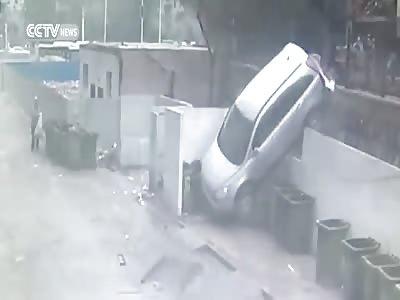 CAR NOSEDIVES AFTER CRASHING INTO GUARDRAIL
