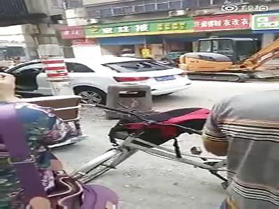 WOMAN DESTROYING AN AUTOMOBILE