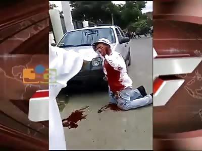 SHOT BY A WOMAN