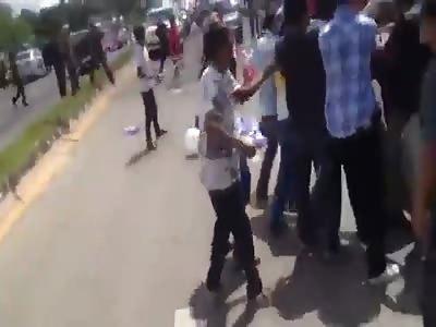 Protesters grab sticks