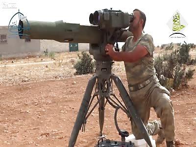 An assad regime armoured earthmover is struck by a TOW ATGM: Tall al-Karasi (Oct 26th, '15)