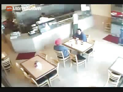Brutal brawl breaks out inside of a restaurant.