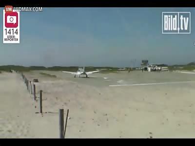 Plane landing on a German beach nearly lands on a guy sunbathing.
